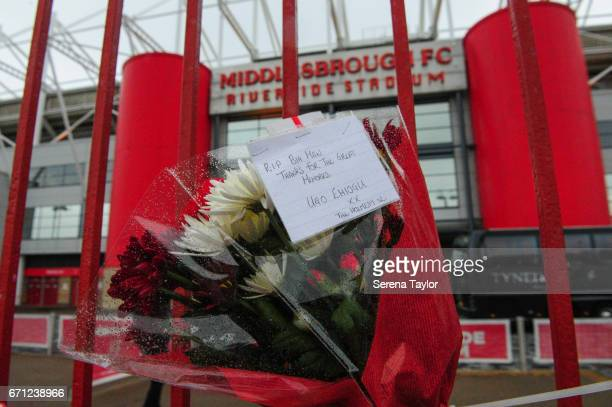 Memorabilia hangs on the metal gates outside the riverside stadium in memory of Ugo Ehiogu during the Premier League 2 match between Middlesbrough...