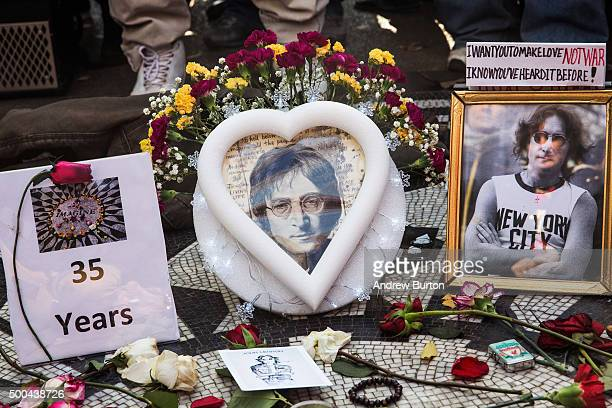 Memorabilia sits a top the 'Strawberry Fields' tile mosaic in Central Park which was created in tribute to the late musician John Lennon to mark the...