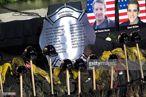 Memorabilla are displayed during a memorial service honoring 19 fallen firefighters at Tim's Toyota Center July 9 2013 in Prescott Valley Arizona The...