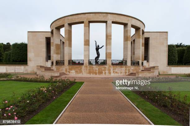 memorial and statue at the normandy american cemetery. - military invasion stock pictures, royalty-free photos & images