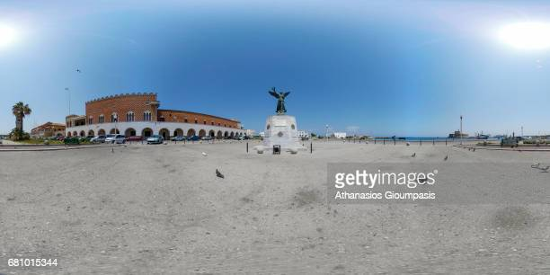 WWII memorial and the Palazzo del Governo on May 03 2017 in Rhodes Greece WII memorial and the Palazzo del Governo located in Mandraki Harbour Is the...