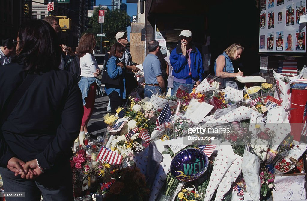 A memorial at the fire station for Engine 54, Ladder 4, Battalion 9, after they lose 15 firefighters in the September 11th attacks, New York City, USA, 13th September 2001.