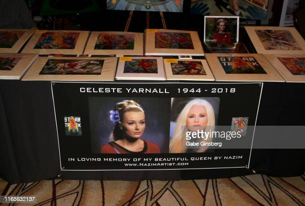 A memorial banner for Celeste Yarnall is displayed on Nazim Artist's booth during the 18th annual Official Star Trek Convention at the Rio Hotel...
