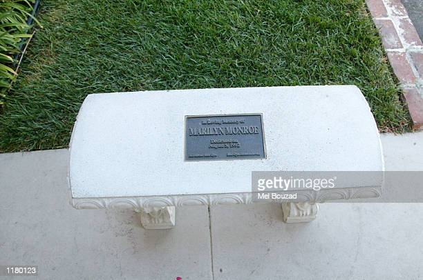 A memorial bench dedicated In Loving Memory of Marilyn Monroe sits near the late actress's crypt on July 26 2002 at the The Westwood Village Memorial...