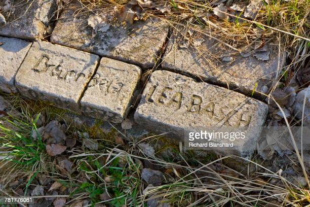 Memorial bricks bearing the names of victims at the site of the former BergenBelsen German Nazi concentration camp in Lower Saxony Germany 2014 The...