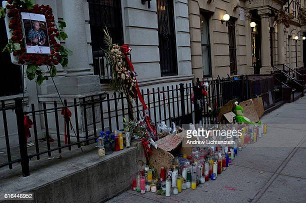 Memorial candles and flowers are left in front of the building where Jarell Mitchell lived on 137th Street in Harlem February 28 2016 Mitchell was...