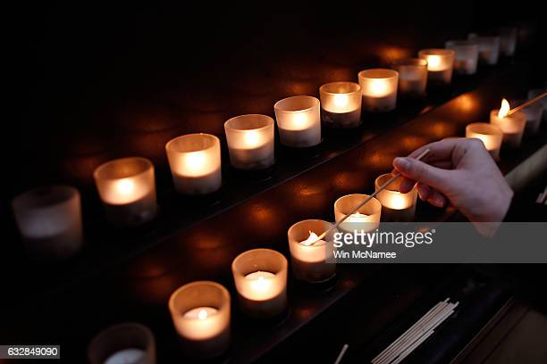 Memorial candles are lit during an International Holocaust Remembrance Day Commemoration at the United States Holocaust Memorial Museum on January 27...