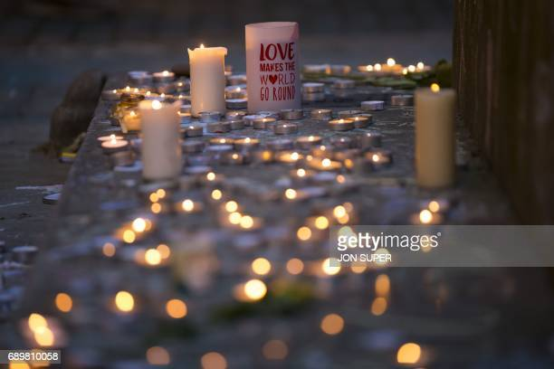 Memorial candles are pictured before a vigil in St Ann's Square in Manchester north west England on May 29 placed in tribute to the victims of the...