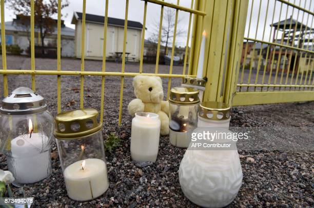 Memorial candles has been left next to the childen's playground where a man stabbed a 3 yearold child in Porvoo Finland on November 13 2017 Child was...