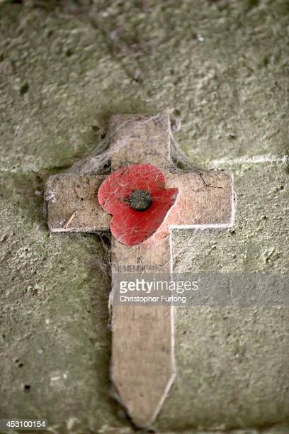 A memorial cross is fixed to the wall inside the fortified Advanced Dressing Station near Essex Farm Cemetery where Canadian doctor Lieutenant...