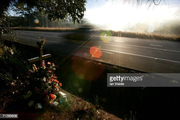 A memorial cross marks the spot on the road where a person died in an unadated car accident on the Pacific Highway June 25 2006 near Kempsey...
