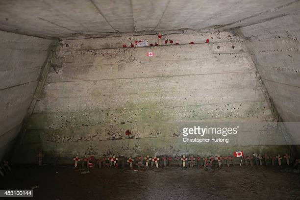 Memorial crosses and poppies sit inside the fortified Advanced Dressing Station near Essex Farm Cemetery where Canadian doctor Lieutenant Colonel...