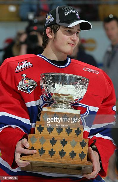 Memorial Cup playoff MVP Dustin Tokarski of the Spokane Chiefs holds his trophy after defeating the Kitchener Rangers in the Memorial Cup...