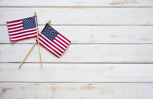 Memorial Day American Flags on White wooden Table 1149135606