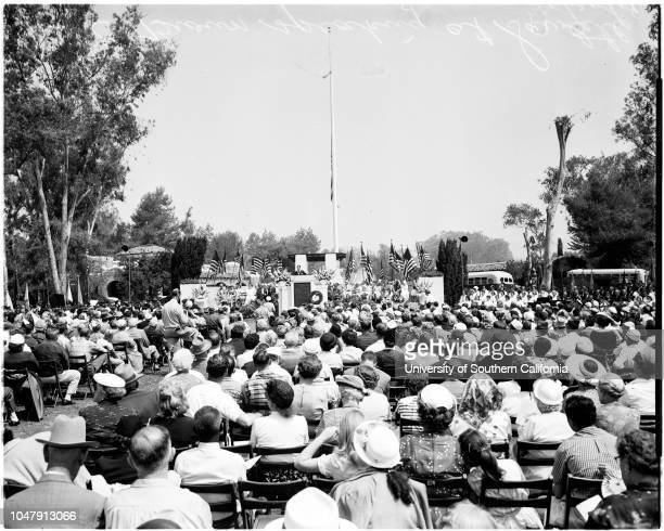 Memorial day at West Los Angeles Veterans Administration center, 30 May 1958. Joe E Brown ;crowd shot;decorating graves.;Caption slip reads:...