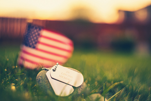 Memorial Day flag and dog tags in evening sunshine 954311052