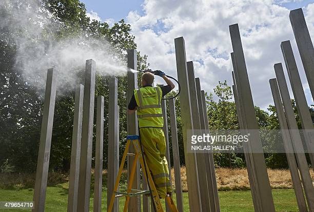 A memorial dedicated to the 52 people that were killed during the 7/7 terror attacks in London is cleaned in London's Hyde Park on July 6 2015...