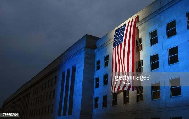 A memorial flag is illuminated near the spot on the side of the Pentagon that was hit by American Airlines Flight 77 on 9/11 September 11 2007 in...
