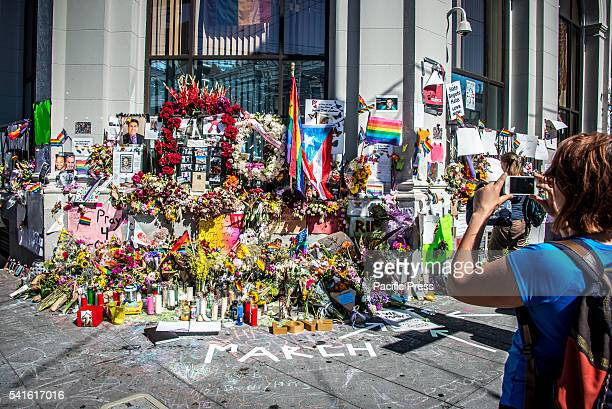 Memorial flowers and photographs for the people who were killed in a Orlando Florida gay club on the corner of Castro Street and 18th Street in...