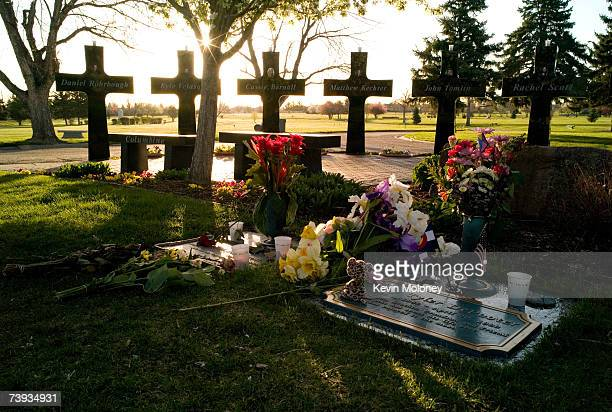 A memorial for 13 victims stands around the graves of three of the Columbine High School shooting victims including Rachel Scott and Corey DePooter...
