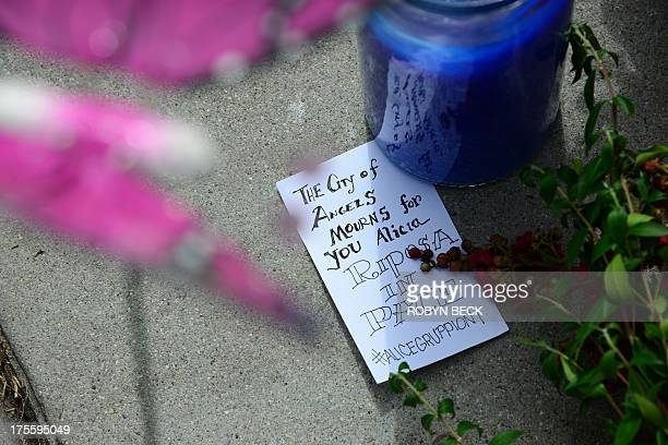 A memorial for 32yearold Italian newlywed Alice Gruppioni is seen on the Venice Beach boardwalk on August 4 2013 One day earlier Gruppioni was killed...