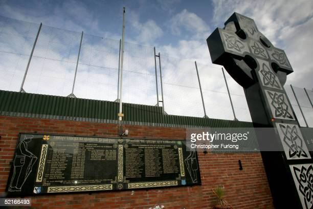 A memorial for IRA volunteers killed in 'the troubles' is seen on February 9 2005 next to the Peace Line fence in Clonard republican area of West...