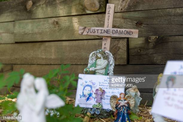 TOPSHOT A memorial for Justine Damond is seen near the alleyway were she was found dead in Minneapolis Minnesota on June 72019 A former Minneapolis...