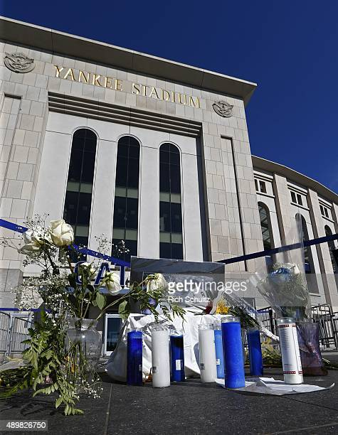 A memorial for Yogi Berra is set up outside Yankee Stadium before a MLB baseball game between the Chicago White Sox and New York Yankees on September...