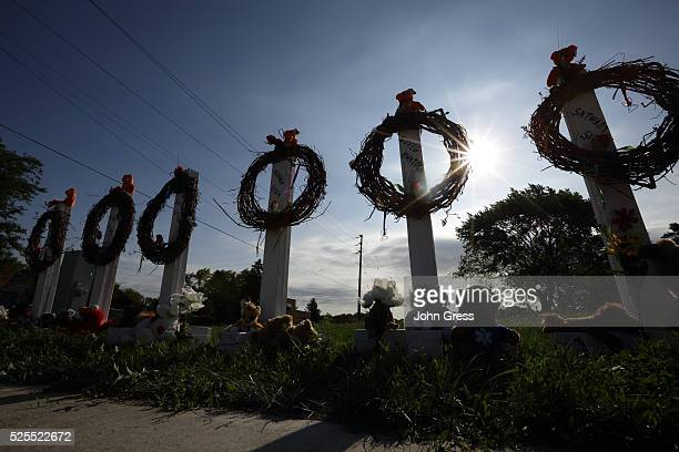 A memorial honors the six victims of a shooting at a Sikh Temple in Oak Creek Wisconsin on August 7 2012 A gunman killed six people and critically...
