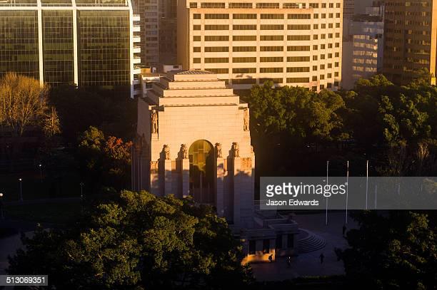 Dawn sunlight touches the ANZAC War Memorial in Hyde Park Sydney.