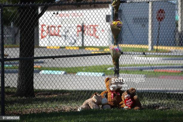 A memorial is seen at Marjory Stoneman Douglas High School on February 18 2018 in Parkland Florida Police arrested 19 year old former student Nikolas...