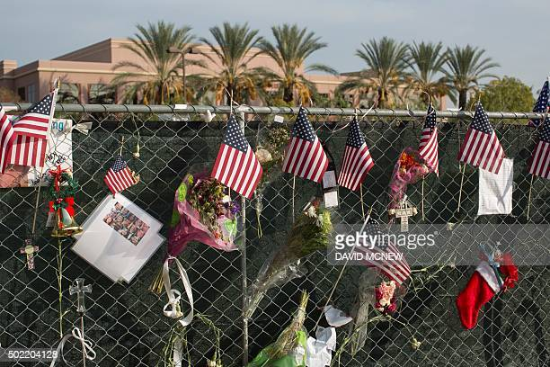 Memorial items hang from a fence surrounding the Inland Regional Center site of the massacre by suspects Syed Farook and Tashfeen Malik earlier this...