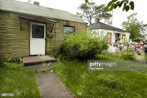 Memorial items surround the childhood home of the late pop star Michael Jackson at 2300 Jackson Street next to an abandoned house on July 2 2009 in...