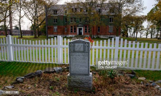 Memorial marker can be seen on the Potter's field at Hart Island October 25, 2019 in New York. - Elaine Joseph's baby daughter is one of around a...