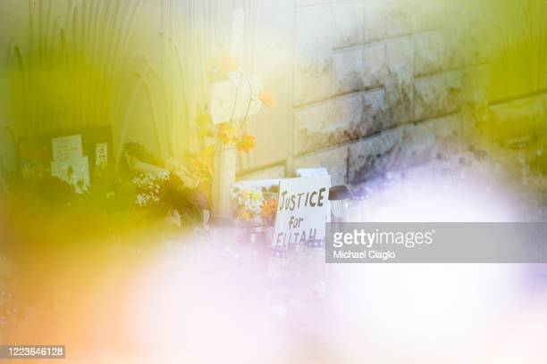 A memorial near where Elijah McClain was forcibly restrained by Aurora police officers is seen through a bouquet of fake flowers on June 30 2020 in...