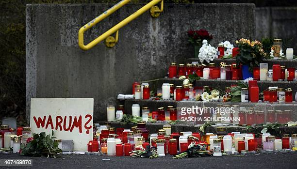 A memorial of flowers and candles and a poster reading 'Why' can be seen in front of the JosephKoenigGymnasium secondary school in Haltern am See...