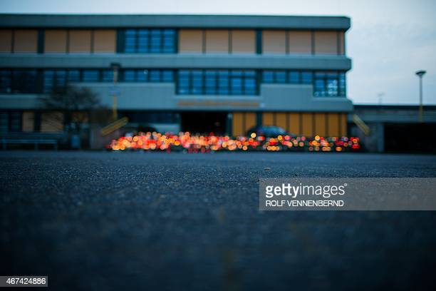 A memorial of flowers and candles in front of the JosephKoenigGymnasium secondary school in Haltern am See western Germany on March 24 from where...