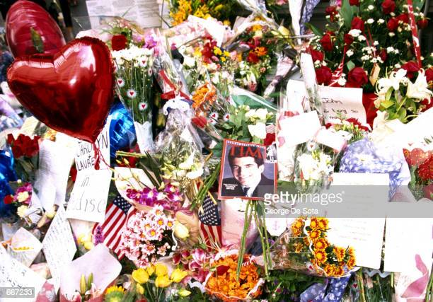 A memorial of flowers cards and American flags are left outside July 20 in front of the residence of John and his wife Carolyn Kennedy Jr in New York...