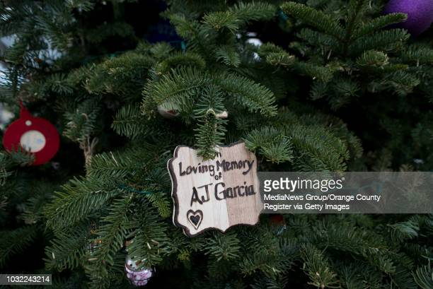 Memorial ornament adorns the Christmas tree at Calafia State Beach in San Clemente on Wednesday, Dec. 20, 2017. This year marks 10 years that Debbie...