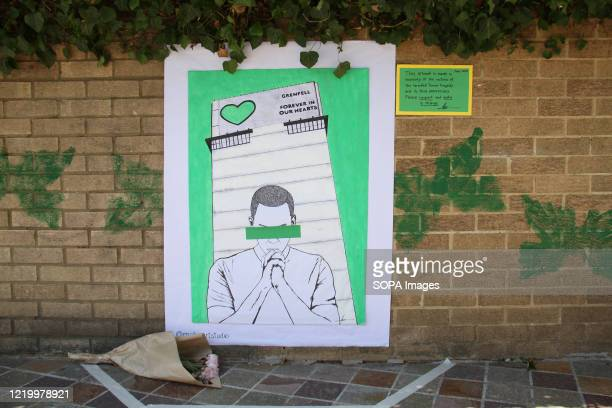 A memorial piece of artwork stuck on a wall by the Notting Hill Methodist Church during the 3rd anniversary of the Grenfell fire Seventytwo people...