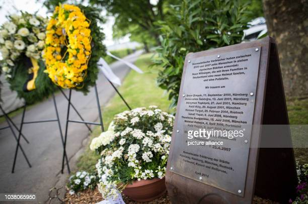 Amemorial plaque and flowers can be seen at a commemoration on the 10th anniversary of the death of police officer Michele Kiesewetter at...