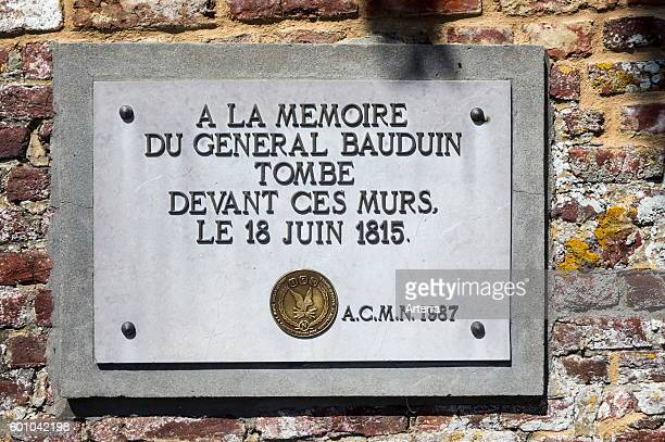 Memorial plaque for the French general Bauduin who fell in front of the garden wall of the Chateau d'Hougoumont farmhouse where British forces faced...