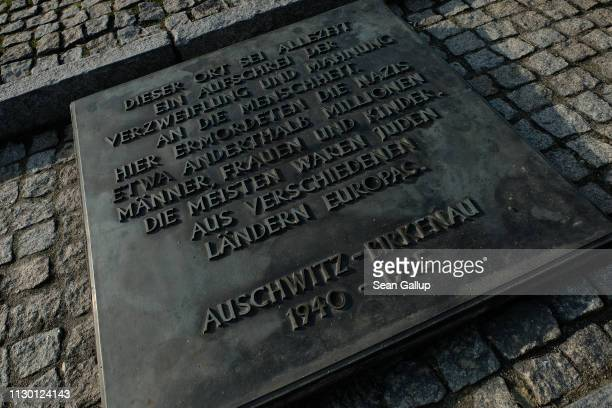 Memorial plaque in German lies at the Auschwitz II-Birkenau memorial concentration camp site on February 15, 2019 in Oswiecim, Poland. Next year will...