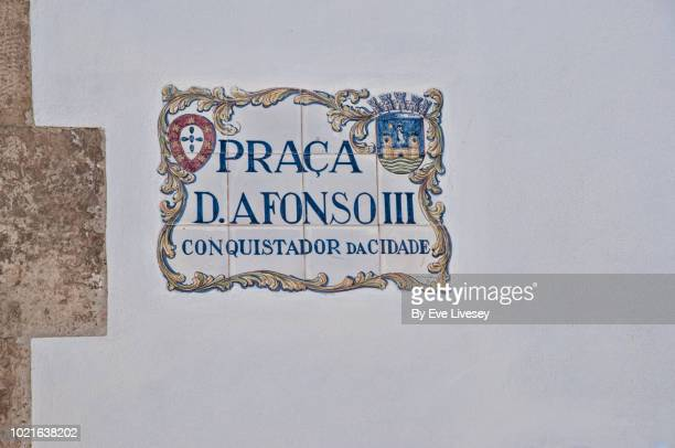 memorial plaque to don afonso iii conqueror of faro - nameplate stock pictures, royalty-free photos & images