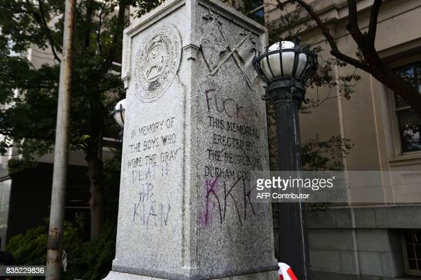 A memorial ro Confederate soldiers is vandalized as protesters gather in front of the old Durham County Courthouse where days earlier a confederate...