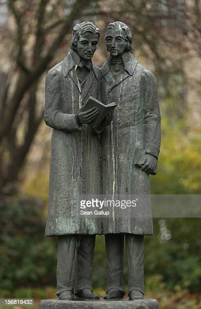 A memorial showing brothers Jacob and Wilhelm Grimm authors of Grimms' Fairy Tales stands in a small park on November 20 2012 in Kassel GermanyThe...