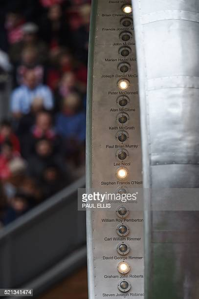A memorial shows names of people who were killed during the Hillsborough Disaster with lights highlighting their names as they are read out during a...