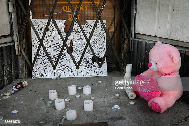 A memorial sits outside a shuttered bakery near the location where a 20yearold man died from a gunshot wound to the head and a 15yearold boy was shot...