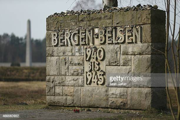 A memorial stands covered with stones left by visitors at the site of the former BergenBelsen concentration camp on March 17 2015 in Lohheide Germany...