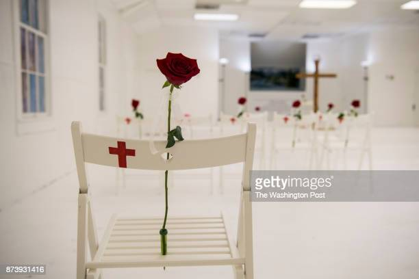 A memorial stands in the Sutherland Springs First Baptist Church one week after 26 people were killed inside in Sutherland Springs Texas on November...